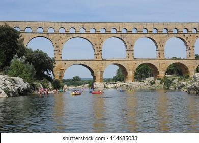 Roman bridge of Pont du Gard over river Gard on France