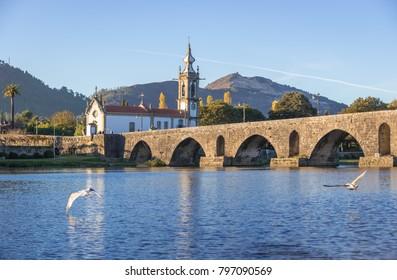Roman bridge in Ponte de Lima town, Portugal - view with Santo Antonio da Torre Velha church