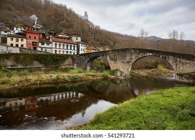Roman bridge of Puente de Arco. Situated in the village of Puente de Arco, 2 Kilometers from Pola de Laviana, Asturias, Spain. It crosses the Nalon river and is formed of two eyes, in half point arcs.