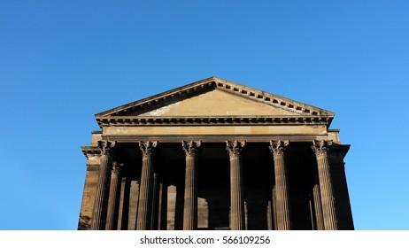 Roman building in a clear blue sky