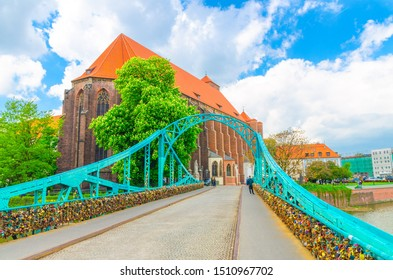 Roman Catholic parish Saint Mary church NMP on Sand island Wyspa Piasek, view through arch of Tumski bridge over Odra Oder river in old town historical city centre of Wroclaw, Poland - Shutterstock ID 1510967702