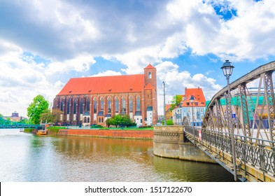 Roman Catholic parish Saint Mary church NMP on the Sand island Wyspa Piasek and Mill Mlynski bridge over Oder Odra river in old historical city centre of Wroclaw, Poland - Shutterstock ID 1517122670