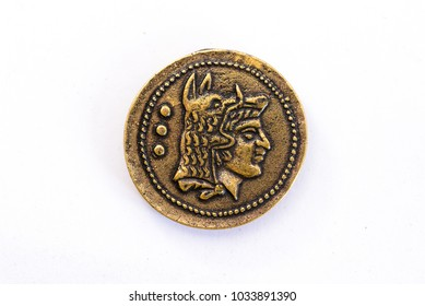 Roman coin with a face