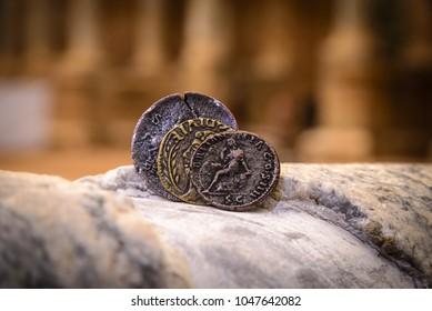Roman coins behind columns