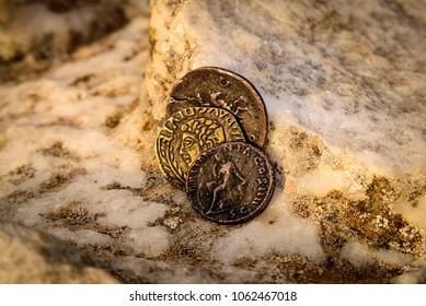 Roman coins on marble