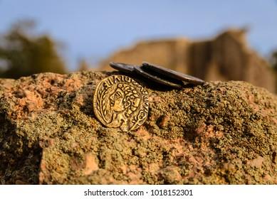 Roman coins on a stone