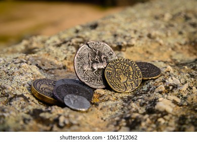 Roman coins over ancient wall