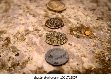 Roman coins in a row