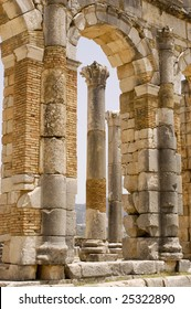 Roman columns framed in an arch at Volubilis, Morocco