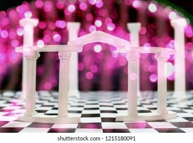 Roman Colums on Black and White Checkerboard Floor