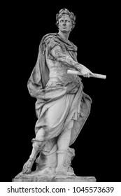 Roman emperor Julius Caesar statue isolated over black background