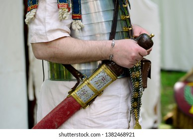 Roman empire soldier holding a Gladius sword detail