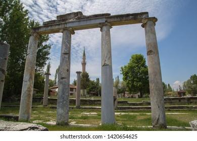 Roman era columns and a minaret at Aizonai, Anatolia, Turkey.