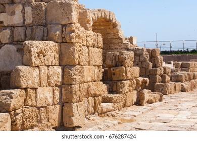 Roman fallen stone wall with door