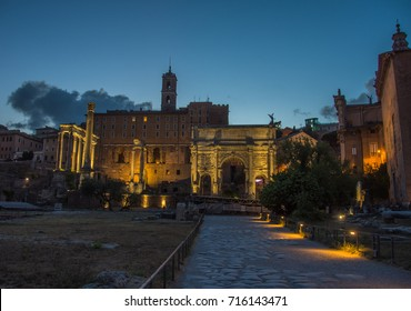 The Roman Forum with the Arch of Septimius Severus in the Imperial Forums Complex in Rome, Italy.