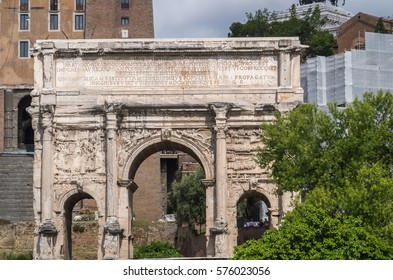 The Roman Forum is a plaza surrounded by many ruins of ancient government buildings in the center of Rome