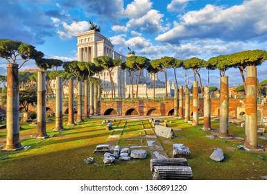 Roman Forum in Rome, Italy. Antique columns. Wrecks of ancient italian roman town. Vittoiano museum on the Capitoline Hill (Capitolium) under Piazza Venecia square. Sunrise above famous landmark.
