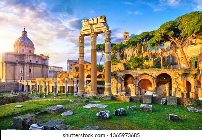 Roman Forum in Rome, Italy. Antique structures with columns and archs. Wrecks of ancient italian roman town. Church of Santi Luca e Martina. Sunrise above famous architectural landmark.