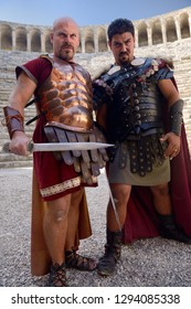 Roman Gladiators scowling before sword fight on stage at Aspendos theatre Aspendos, Antalya, Turkey - November 8, 2012