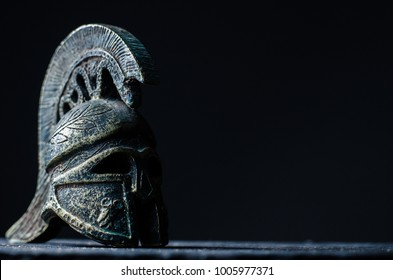 Roman helmet on a dark background