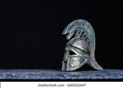 Roman helmet on dark background