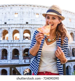 Roman Holiday. Portrait of happy stylish tourist woman in Rome, Italy eating pizza