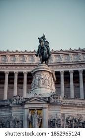 Roman horse sculpture in Piaza Venecia at sunset, Rome, Italy.