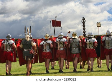 Roman Legion Marches on to War with swords drawn under Stormy Skies in Northumberland, England