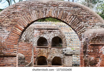 Roman necropolis  columbarium graves in Ostia Antica ruins and view of the arch, Rome - Italy