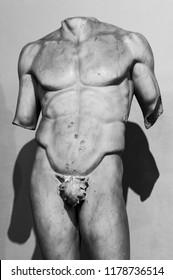 Roman nude male body in black and white