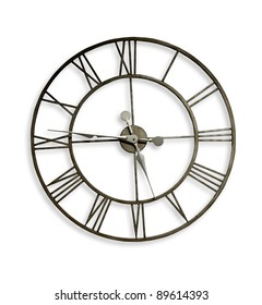 A Roman numeral metal wall clock. Clipping path included.