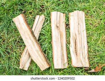 Roman numeral. Roman numerals made from oak. Old wood numbers. Old roman antique alphabet number on green grass background. Number twelve.