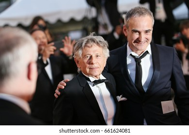 Roman Polanski and Olivier Assayas attend the 'Based On A True Story' screening during the 70th annual Cannes Film Festival at Palais des Festivals on May 27, 2017 in Cannes, France.