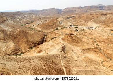 Roman Ramp at fortress Masada and Panorama of Judaean Desert mountains, Israel