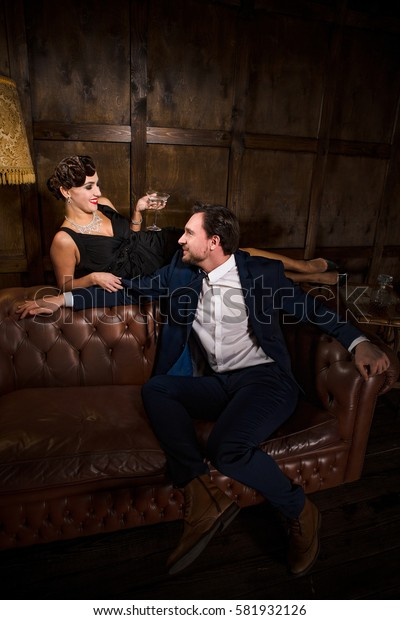 Roman, relations between millionaire and elegant lady. Couple resting and relaxing in restaurant. Luxury couple spending free time.