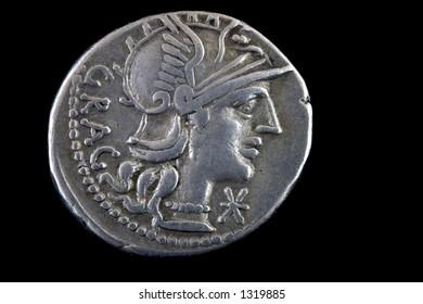 Roman republican denarius of Lucius Antestius Gragulus 136 BCE. Helmeted head of Roma right ,GRAG behind.