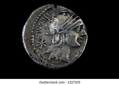 Roman republican denarius of M. Sergius Silus. 116 BC.  Helmeted head of Roma right ,Roma behind.