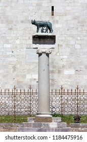 Roman she-wolf bronze statue on the top of a column outside the Basilica of Aquileia, Italy
