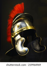 Roman soldier helmet in black background