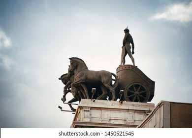 Roman soldier on horse war wagon at rooftop in Madrid, Spain.