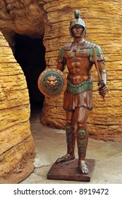 Roman soldier statue guarding a rocky cave (tomb).