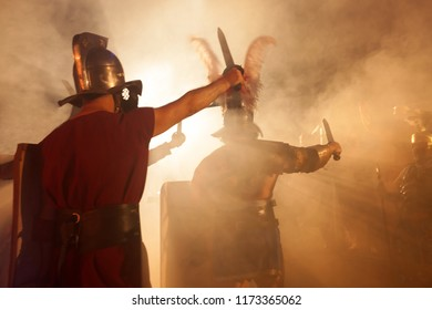 Roman soldiers at attack with swords in the right hand.