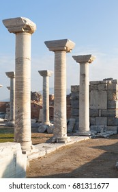 Roman stone pillars and statue and altar ruins room in ephesus Archaeological site in turkey