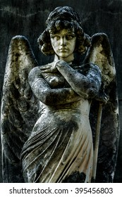 Roman stone statue of an angel with wings and motives