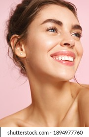 Romance and beauty. Close up of happy young woman with nude makeup and white perfect smile, looking away dreamy about valentines day, standing on pink background.