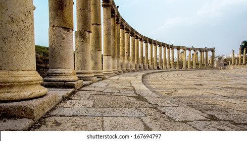 Romand and Ancient Greek typical columns in Rome City of Jerash in Jordan. Columns are offset on the lef side of photo