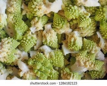 romanesco broccoli (Brassica oleracea) aka Romanesque cauliflower or Buzzy Broc vegetables vegetarian and vegan food