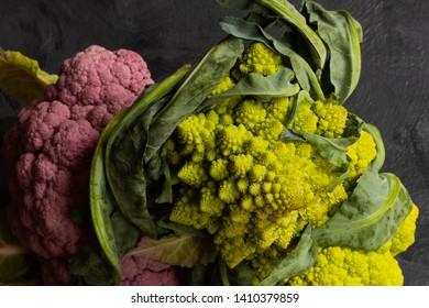romanesco, purple and green cauliflowers from above horizontal