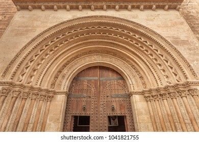 Romanesque Almoina Gate, entrance in Valencia Cathedral, Spain