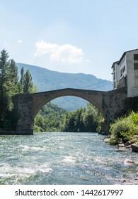 Romanesque bridge with a single arch, in Gerri de la Sal, on the Noguera Pallaresa river. Catalan Pyrenees. Catalonia, Spain.